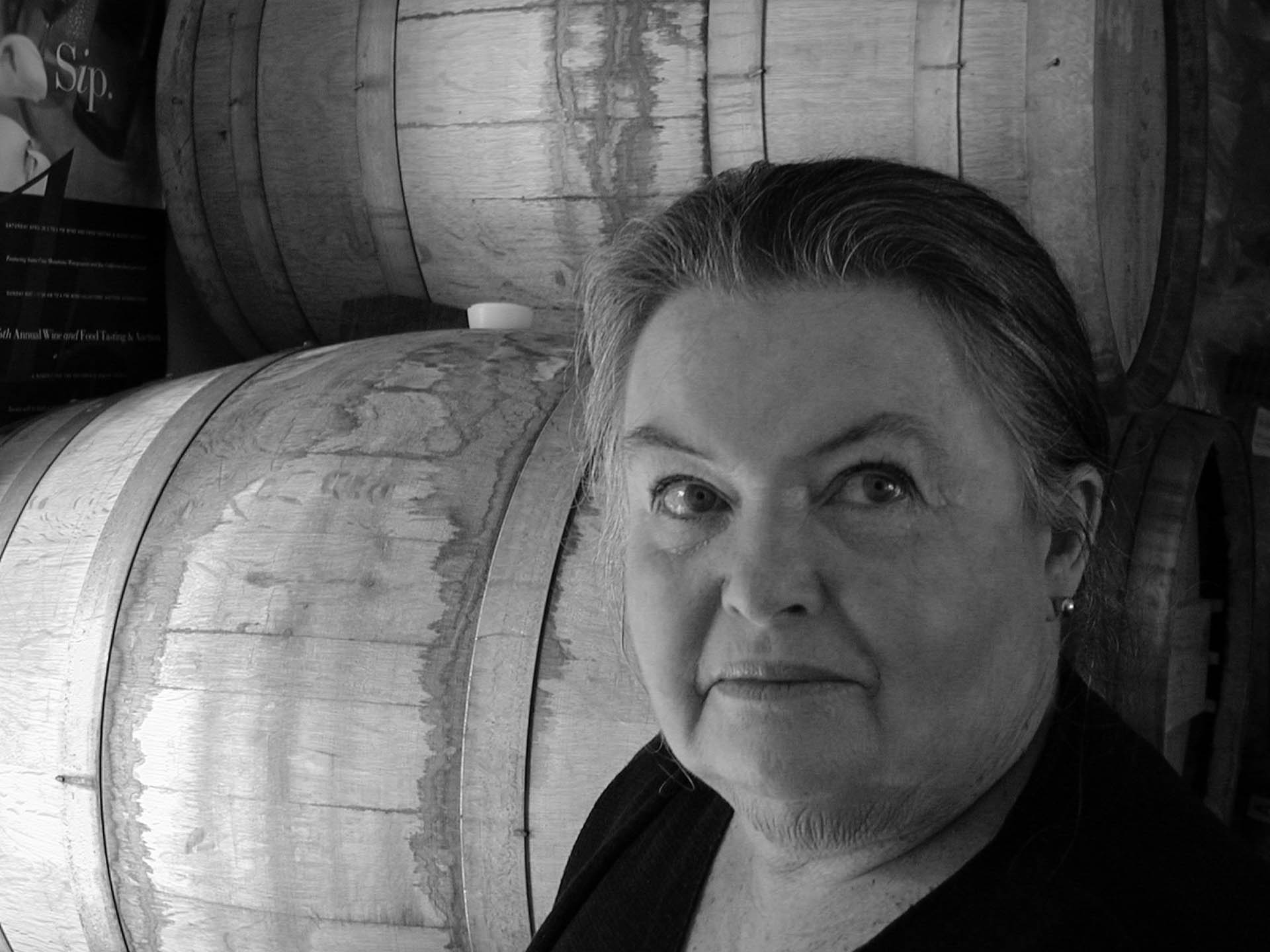 Kathryn and Wine Casks at Kathryn Kennedy Winery